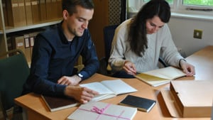 Carl Graves and Maria Rodriguez Rubin consult archive material at the EES